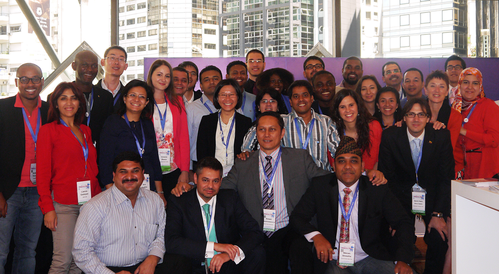 A group photo of the Buenos Aires, Argentina Fellowship Participants with a view of tall buildings in the background