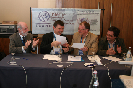 The .ru signing. Left to right: Vint Cerf (ICANN chairman); Paul Twomey (ICANN president and CEO); Andrew Romanov (.ru); Dmitry Burkov (.ru / RIPE)