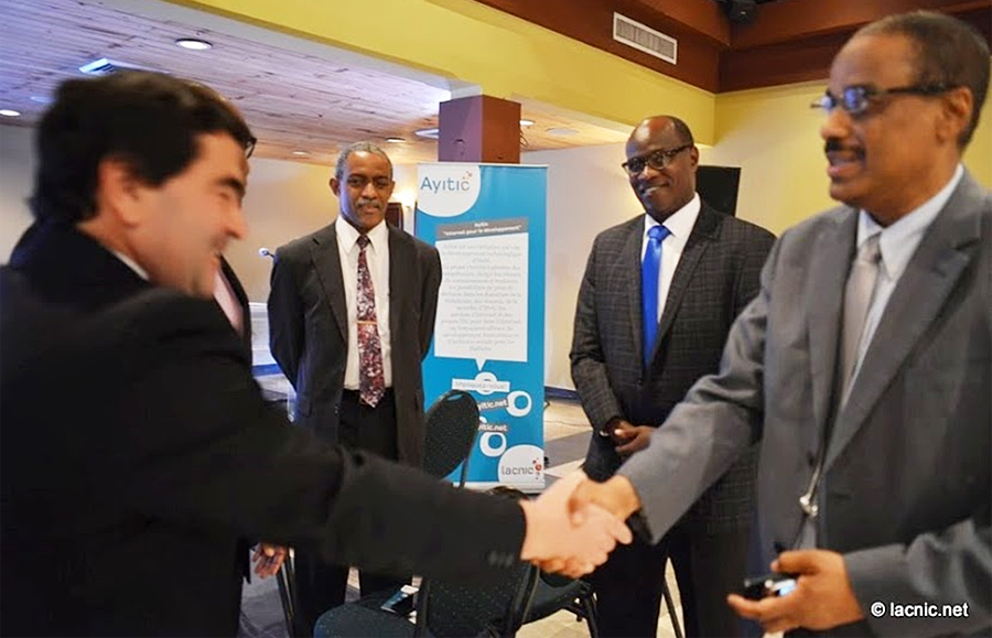 Foreground: Raul Echeberría, LACNIC CEO and Harry Lindor, Technical Advisor of the Ministry of Public Works, Transport and Communications. Background: Albert Daniels, ICANN and Shernon Osepa, Internet Society