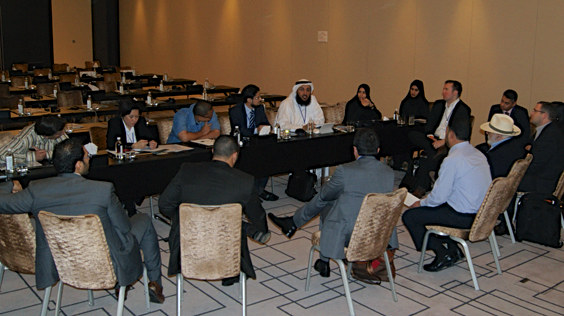 Participants break into groups, sitting around a table to discuss the day's topics